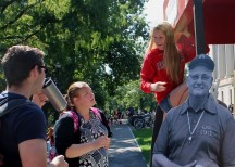 Rachel Pry, a second-year in material science engineering at OSU, fixes a sign on top of her booth whileAndrew Drozd, a fourth-year in neuroscience at OSU, and another student look on during Founder's Day, Thursday, Sept. 17, 2015 at Ohio State University in Columbus, Ohio. Ohio Staters, Inc. and University Libraries held the event in commemoration of the first day of classes at Ohio State Sept. 17, 1873.