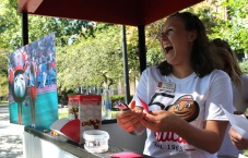 Victoria Alesi, a fourth-year in dance and international studies, laughs as she punches a student's trivia ticket at Founder's Day on the Oval at Ohio State University in Columbus, Ohio Thursday, Sept. 17, 2015. Ohio Staters, Inc., an Ohio State club comprised of faculty, staff and students, and University Libraries put on the event in commemoration of the first day of classes at Ohio State Sept. 17, 1873.