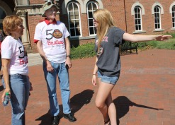 Debbie Burton, a 1975 graduate of Ohio State University, and her husband Herb Burton, a 1972 graduate of Ohio State University, talk to Rachel Pry, a second year in materials science and engineering, outside University Hall Thursday, Sept. 17, 2015 during a Founder's Day event in which the Burtons participated on the Oval and at University Hall at Ohio State University in Columbus, OH. The Burtons celebrated their wedding anniversary by coming to OSU. Ohio Staters, Inc., an Ohio State club comprised of faculty, staff and students, and University Libraries put on the event in commemoration of the first day of classes at Ohio State Sept. 17, 1873.